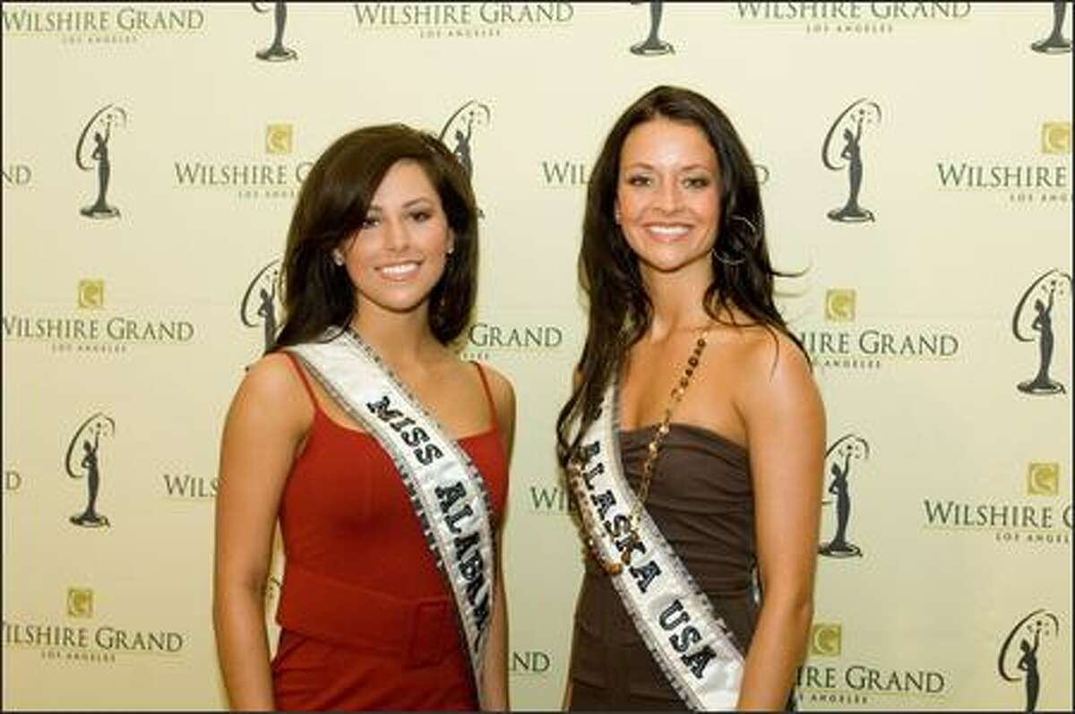 Rebecca Moore, Miss Alabama USA 2007, and Blair Chenoweth, Miss Alaska USA 2007, pose at the Wilshire Grand Hotel in Los Angeles on March 8 before registration and fittings for the Miss USA 2007 competition.