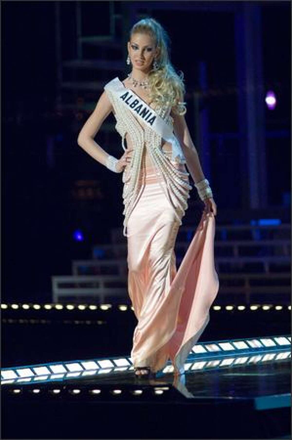 Sadina Alla, Miss Albania 2007, competes in an evening gown of her choice during the 2007 Miss Universe Presentation Show at Auditorio Nacional in Mexico City on May 23. During the Presentation Show, each is judged by a preliminary panel of judges in individual interview, swimsuit and evening gown categories. The scores will be tallied and the top 15 contestants will be announced during the broadcast of the finals on May 28 (9 p.m. Pacific, tape-delayed).