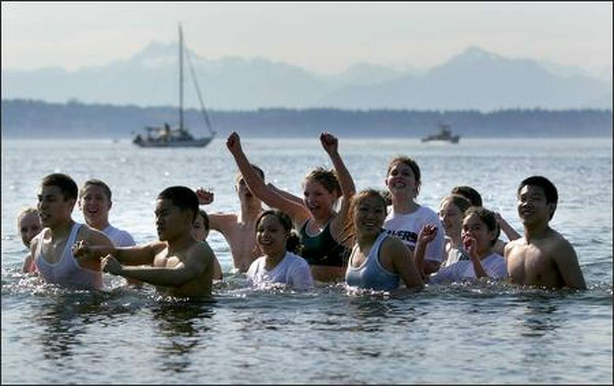 Ballard High School track team sprinters practice and perform their sprints in the cold Puget Sound water on an unusually warm spring day on Friday in Seattle. The team sometimes performs water resistance training but this was the first time the team had done it in Puget Sound.