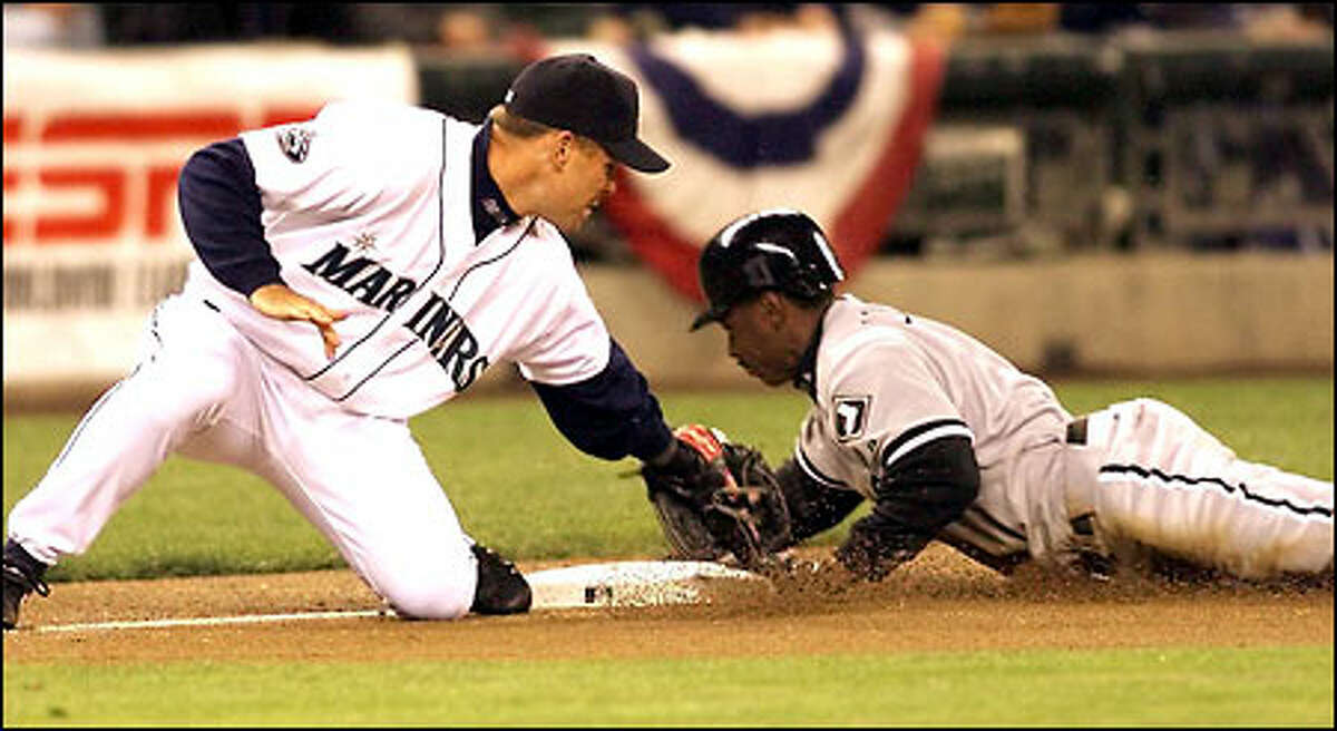 Kenny Lofton steals third as Jeff Cirillo attempts the tag in the first inning. Lofton scored on the next play, putting the Sox up 1-0.