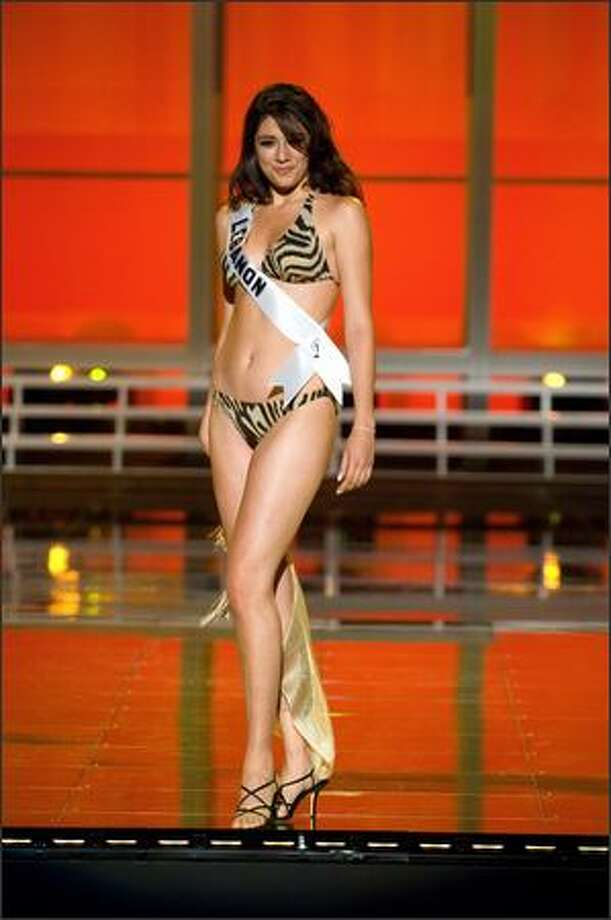Nadine Njeim, Miss Lebanon 2007, competes in her BSC Swimwear Thailand swimsuit and Nina Shoes during the 2007 Miss Universe Presentation Show at Auditorio Nacional in Mexico City on May 23. During the Presentation Show, each contestant is judged by a preliminary panel of judges in individual interview, swimsuit and evening gown categories. The scores will be tallied and the top 15 contestants will be announced during the broadcast of the finals on May 28 (9 p.m. Pacific, tape-delayed). Photo: Miss Universe L.P., LLLP