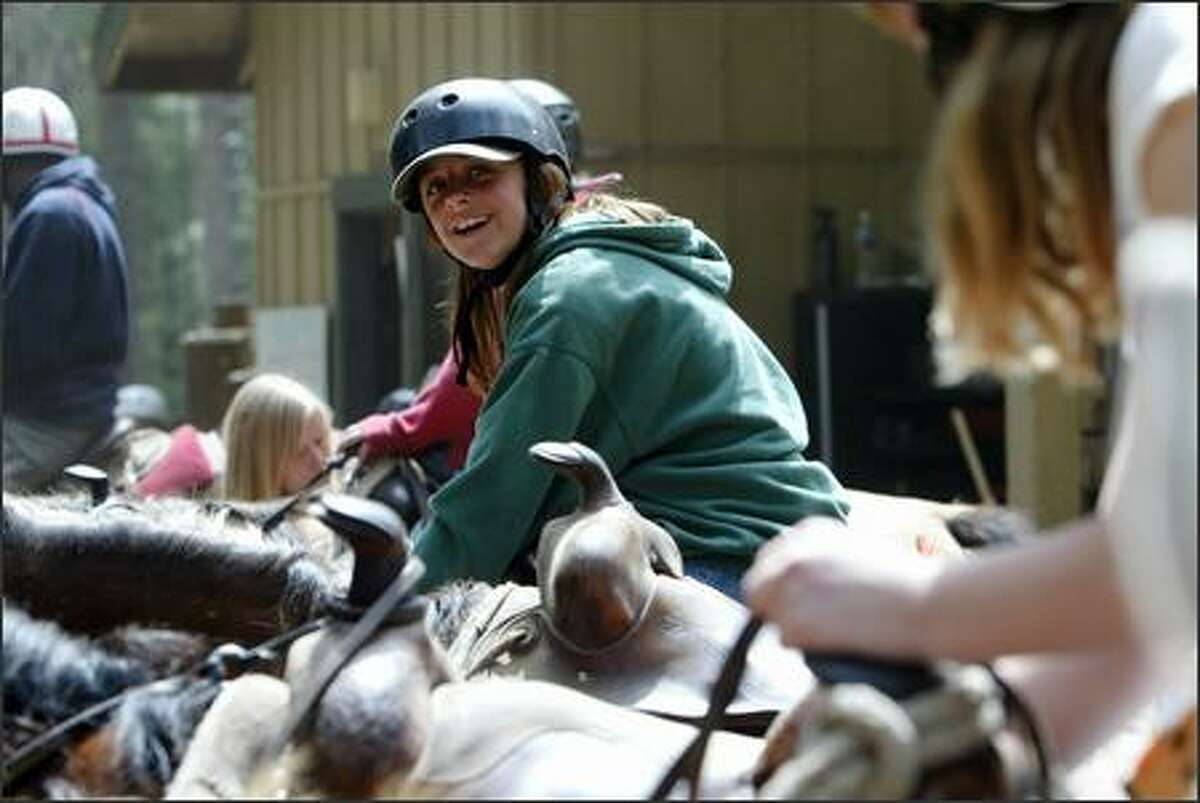 Campers Blake Raynor, 12, gets ready to for a horseback riding trip at the Icicle Outfitters and Guides at Lake Wenatchee State Park on Wednesday June 27,2007. The summer camp, code named