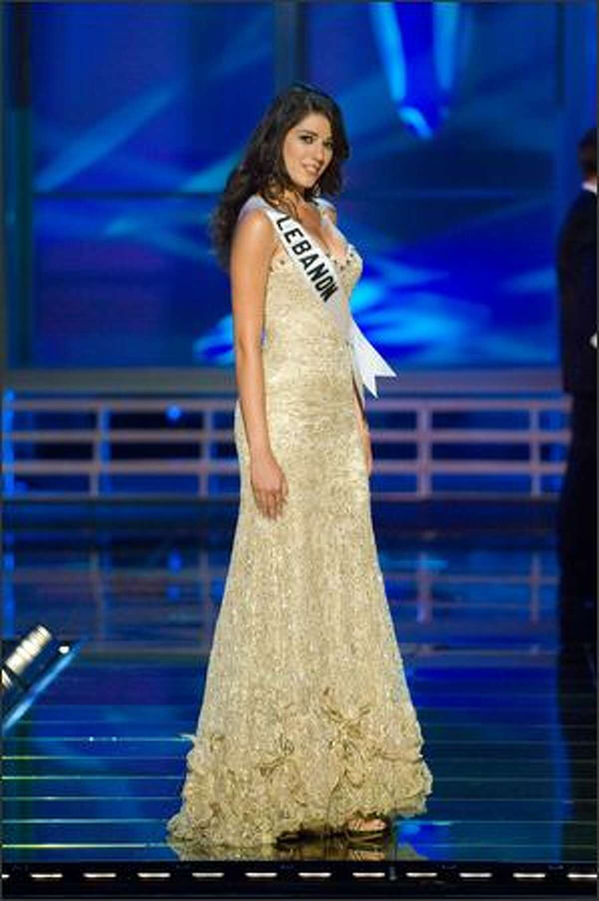 Nadine Njeim, Miss Lebanon 2007, competes in an evening gown of her choice during the 2007 Miss Universe Presentation Show at Auditorio Nacional in Mexico City on May 23. During the Presentation Show, each is judged by a preliminary panel of judges in individual interview, swimsuit and evening gown categories. The scores will be tallied and the top 15 contestants will be announced during the broadcast of the finals on May 28 (9 p.m. Pacific, tape-delayed).
