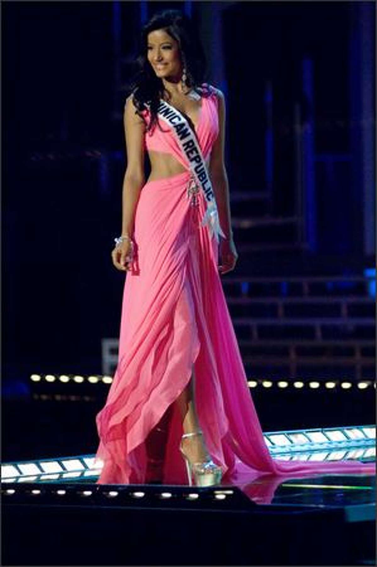 Massiel Taveras, Miss Dominican Republic 2007, competes in an evening gown of her choice during the 2007 Miss Universe Presentation Show at Auditorio Nacional in Mexico City on May 23. During the Presentation Show, each is judged by a preliminary panel of judges in individual interview, swimsuit and evening gown categories. The scores will be tallied and the top 15 contestants will be announced during the broadcast of the finals on May 28 (9 p.m. Pacific, tape-delayed).