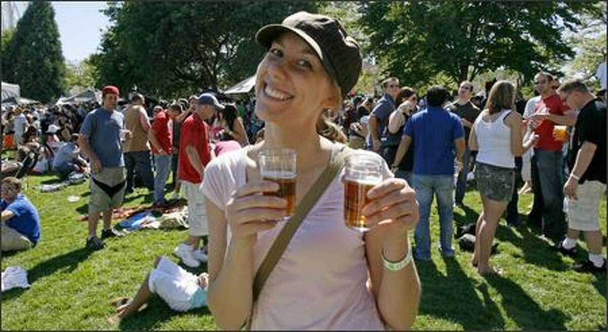 The lines for beer were so long, Liz Demer got into the shortest line she could find to get two four-ounce beers for herself and her friend.