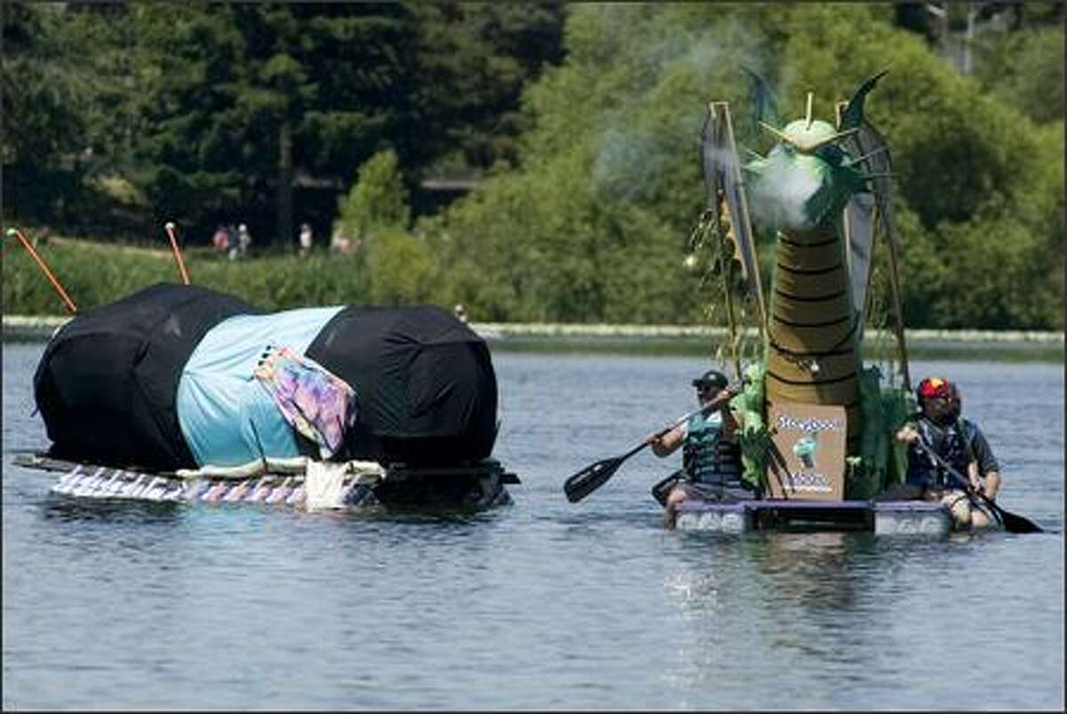 A dragon boat, complete with bellowing steam, passes a bug boat as they row towards the shore.