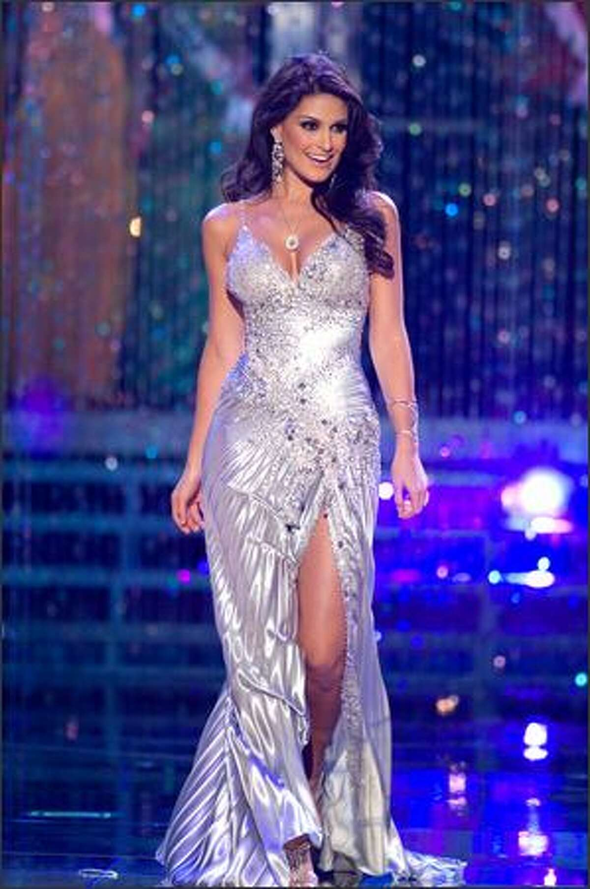 Ly Jonaitis, Miss Venezuela 2007, participates in the evening gown portion of the broadcast as one of the 10 finalists.