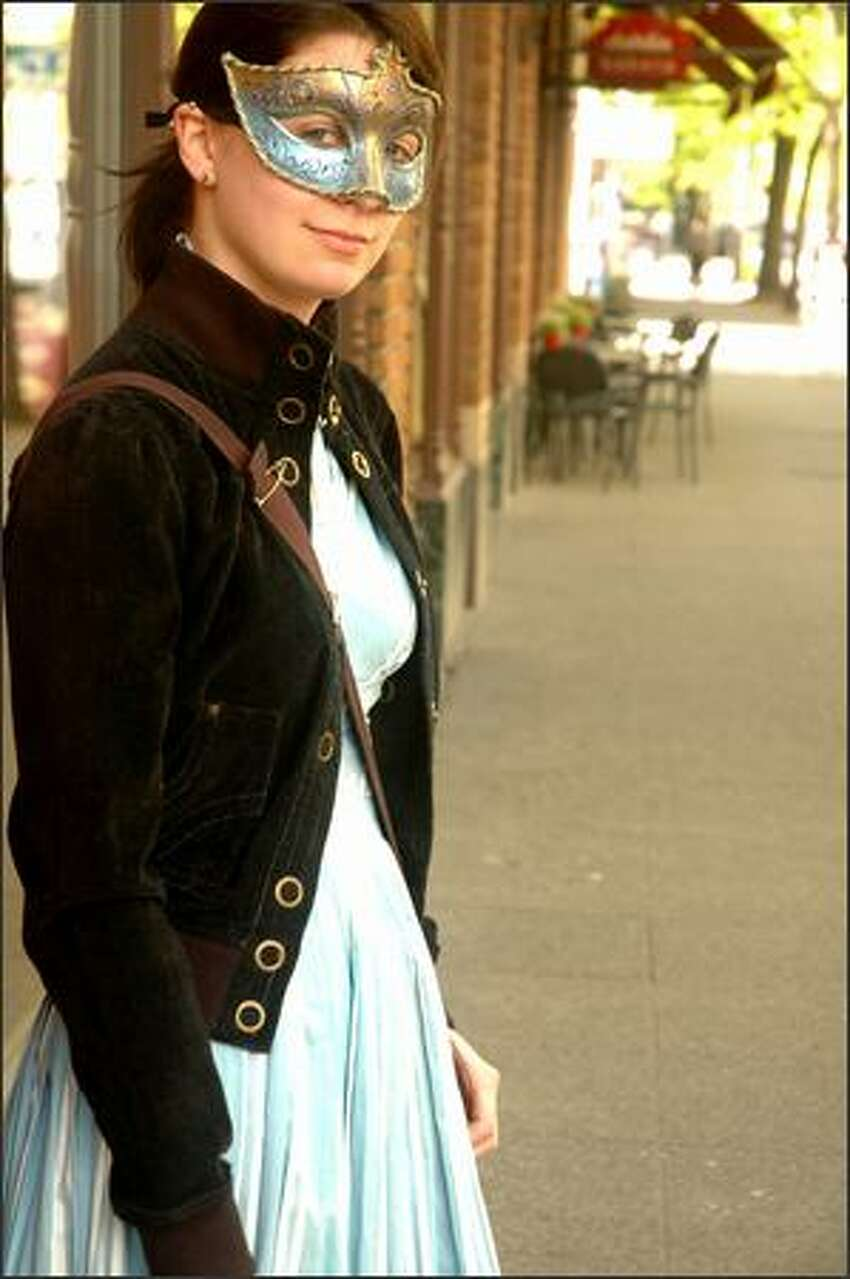 Sarah Sullivan, standing on a sidewalk in Belltown, calls her style