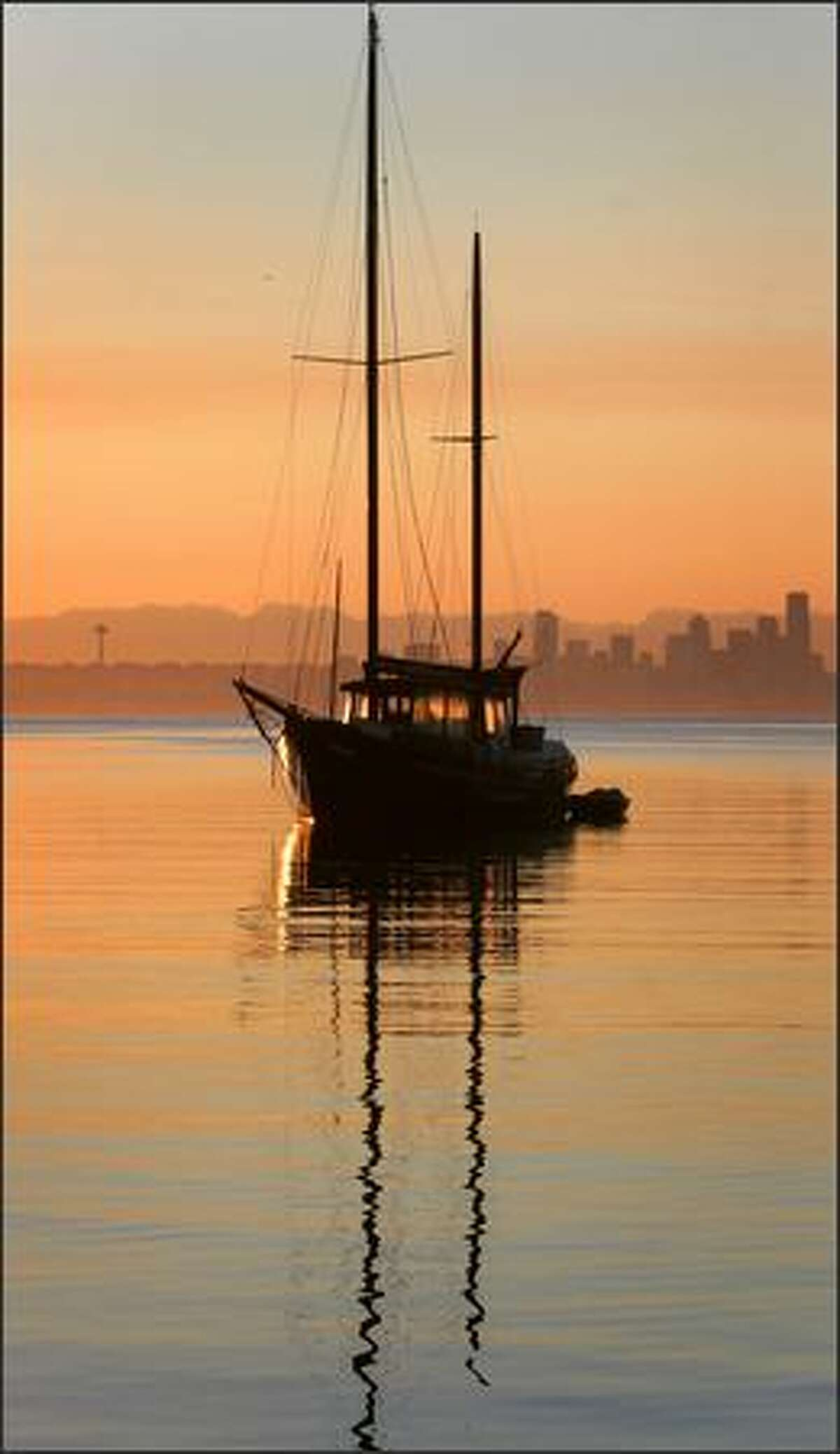 A sailboat at sunrise in Eagle Harbor.