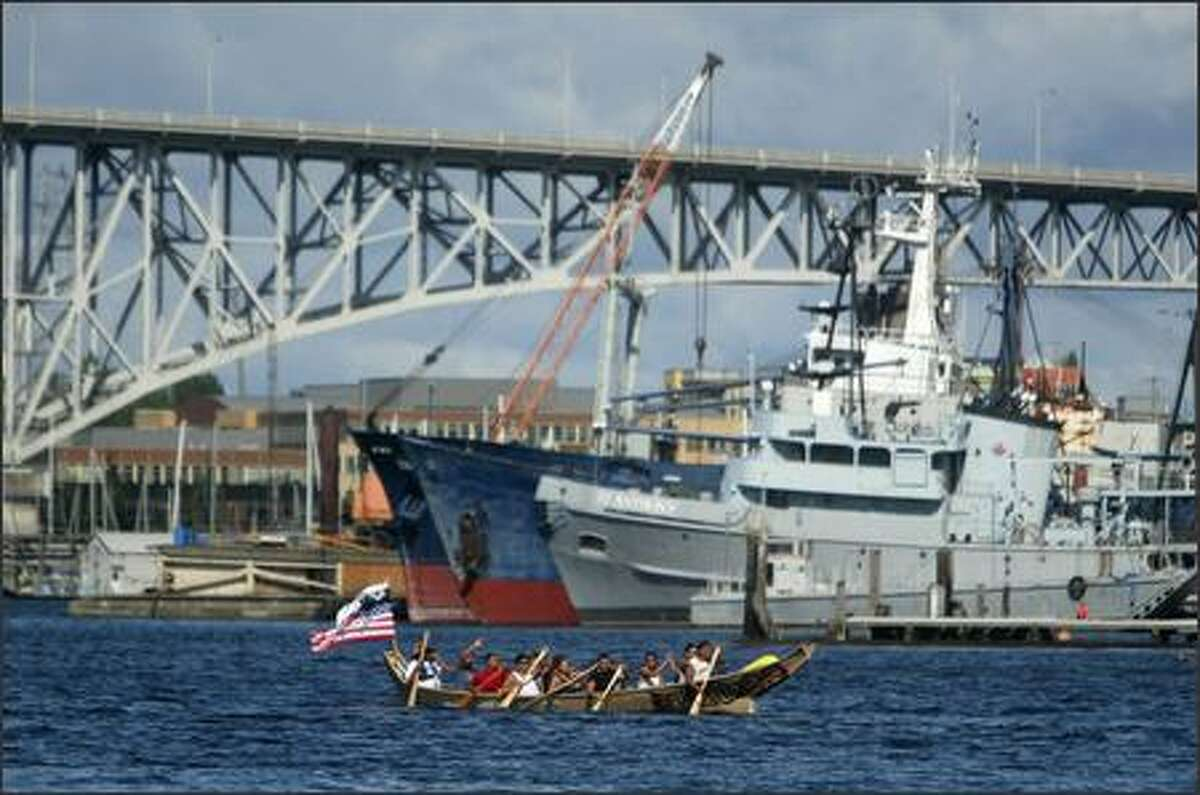 Native canoe paddlers on Lake Union.