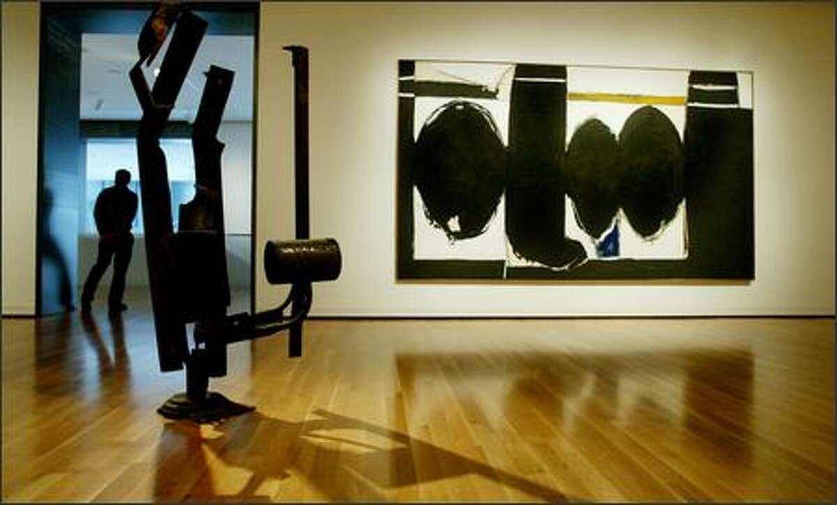 """Two pieces from Seattle Art Museum's collection of modern art: Richard Stankiewicz's 1959 sculpture """"Big C"""" and Robert Motherwell's 1971-72 painting """"Elegy to the Spanish Republic #124."""""""
