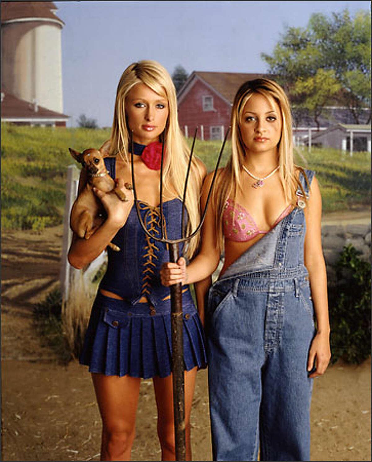 Society princesses Paris Hilton, left, and Nicole Richie brave life on the farm in