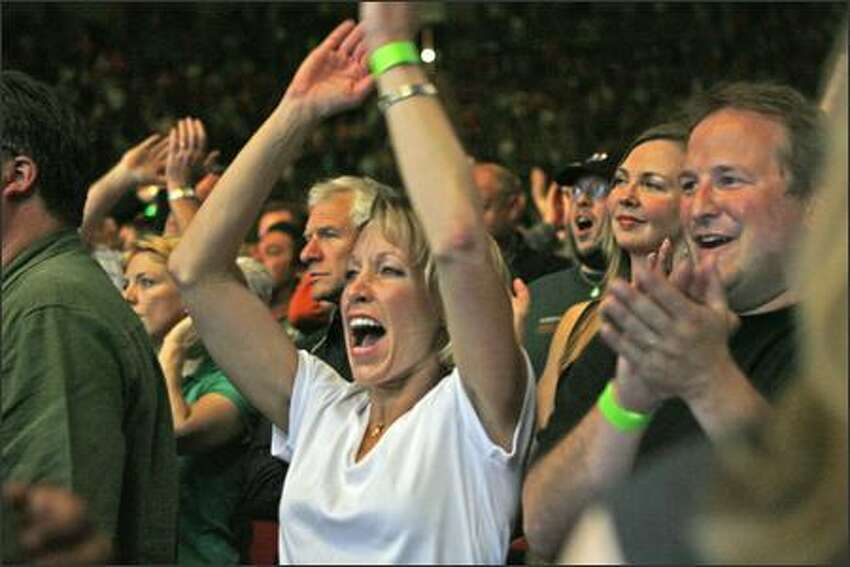 Fans cheer The Police performing at KeyArena in their first U.S. concert in 23 years.