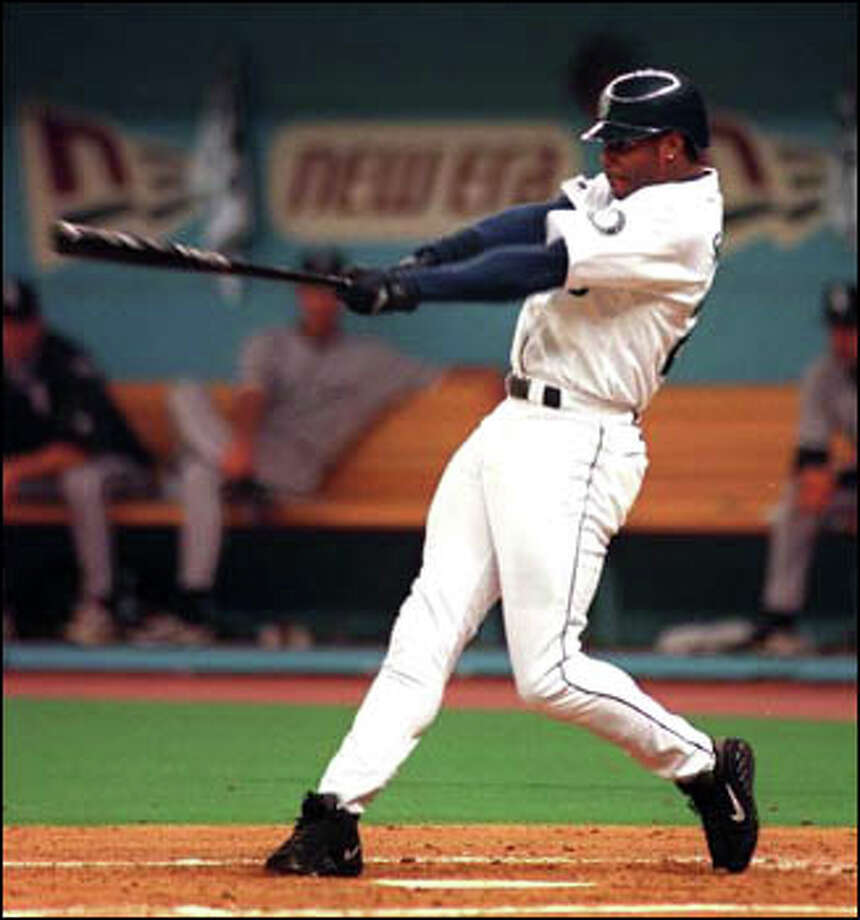 Ken Griffey Jr. slams his first home run of the 1999 season in the Kingdome. Photo: Grant M. Haller, Seattle Post-Intelligencer