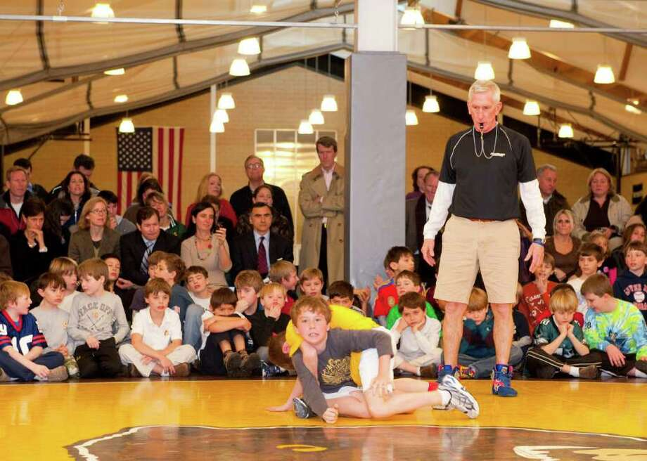 Brunswick School first-, second-, third- and fourth-graders did some tricky sprawls, bridges and half nelsons at the Lower School Wrestling Tournament, a Brunswick tradition every February. Founded 29 years ago by coach Tim Ostrye, assistant athletic director, the tournament is a celebration of individual effort, determination, hard work, sportsmanship and fair play. Photo: Contributed Photo / Greenwich Time Contributed