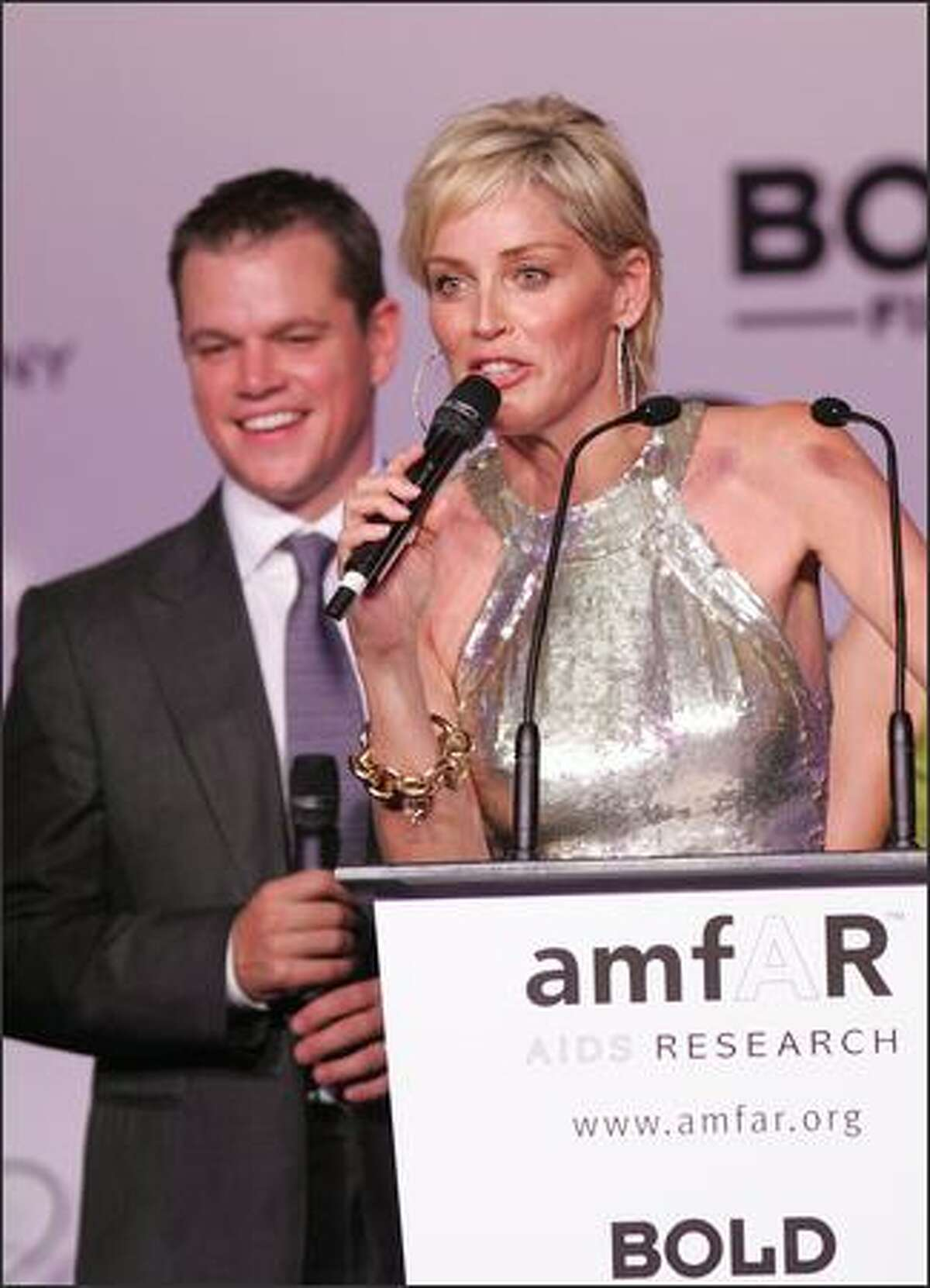Actors Matt Damon and Sharon Stone conduct an auction at the Cinema Against Aids 2007 in aid of amfAR at Le Moulin de Mougins in Mougings on Wednesday in Cannes, France. The amfAR foundation raises funds for research, education and treatment of AIDS / HIV worldwide. (Peter Kramer/Getty Images)