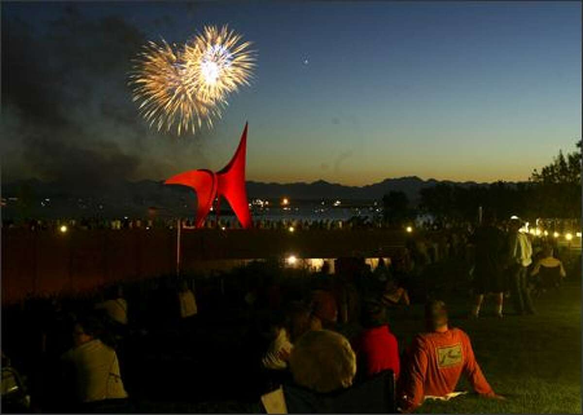 """People were able to watch the 34th annual Fourth of Jul-Ivar's fireworks display for the first time from the Olympic Sculpture Park. In the foreground is Alexander Calder's sculpture """"Eagle"""" (1971)."""