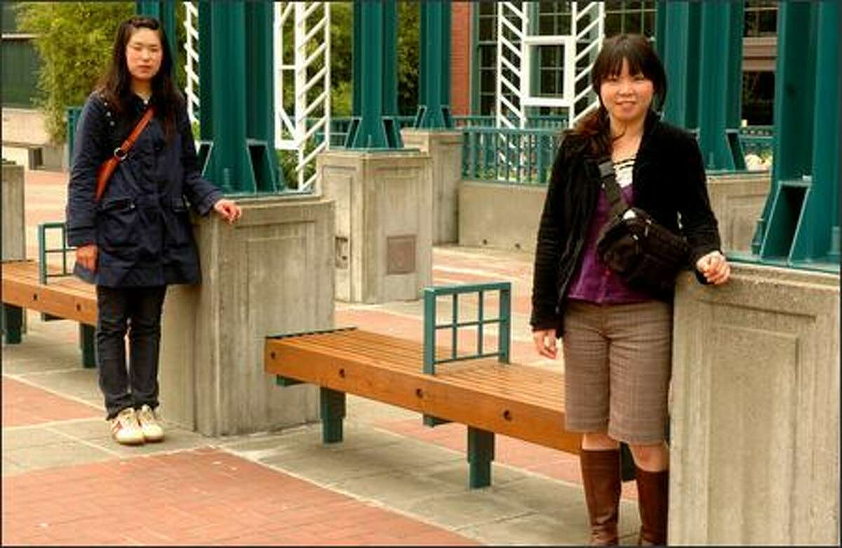 Manami Kondo and Kimiko Kimura wait for a bus in the International District. Most of their clothing comes from their homeland of Japan.