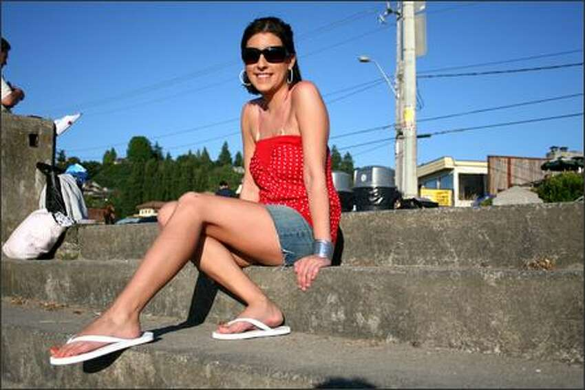 Karissa Finch enjoys the sunshine down at Alki Beach. She describes her style as