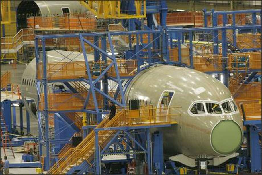 "Overall view of the first Boeing 787 Dreamliner being built at Boeing's Everett plant. Sections 41 (The nose section) and sections 43-46 a center section are shown here with all the special ""Tools"" Boeing has designed to hold the parts together while its pieces are connected. The rear section can be seen in the background. Photo: Grant M. Haller, Seattle Post-Intelligencer"