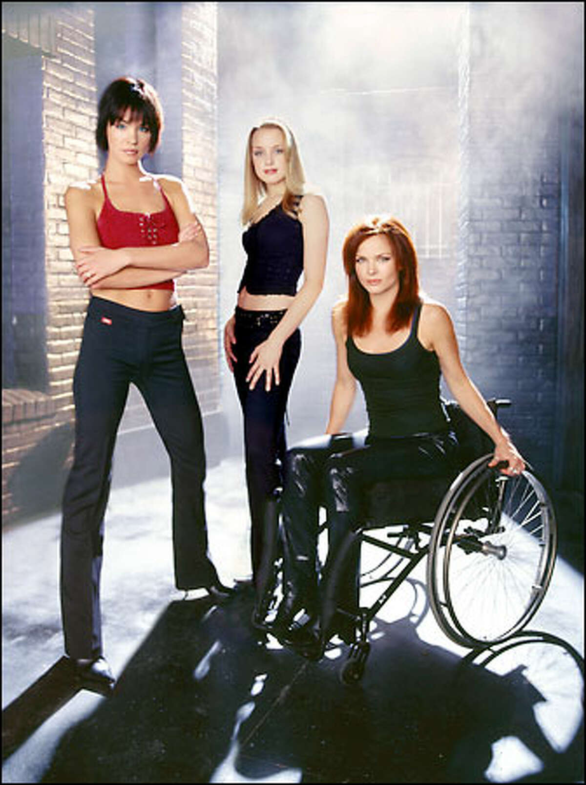 """""""Birds of Prey,"""" based on a DC Comics title, features a trio of heroines protecting New Gotham City seven years after Batman's sudden departure. The series stars (l-r) Ashley Scott as Helena Kyle (the savage Huntress), Rachel Skarsten as Dinah Lance (the telepathic Black Canary) and Dina Meyer as Barbara Gordon (computer whiz Oracle)."""