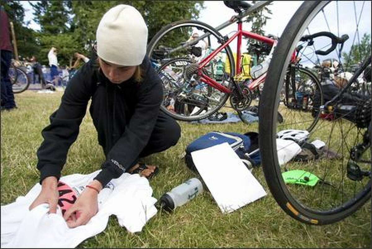 Rachel Langton of Seattle pins her race number on a shirt before the Benaroya Research Institute Triathlon.