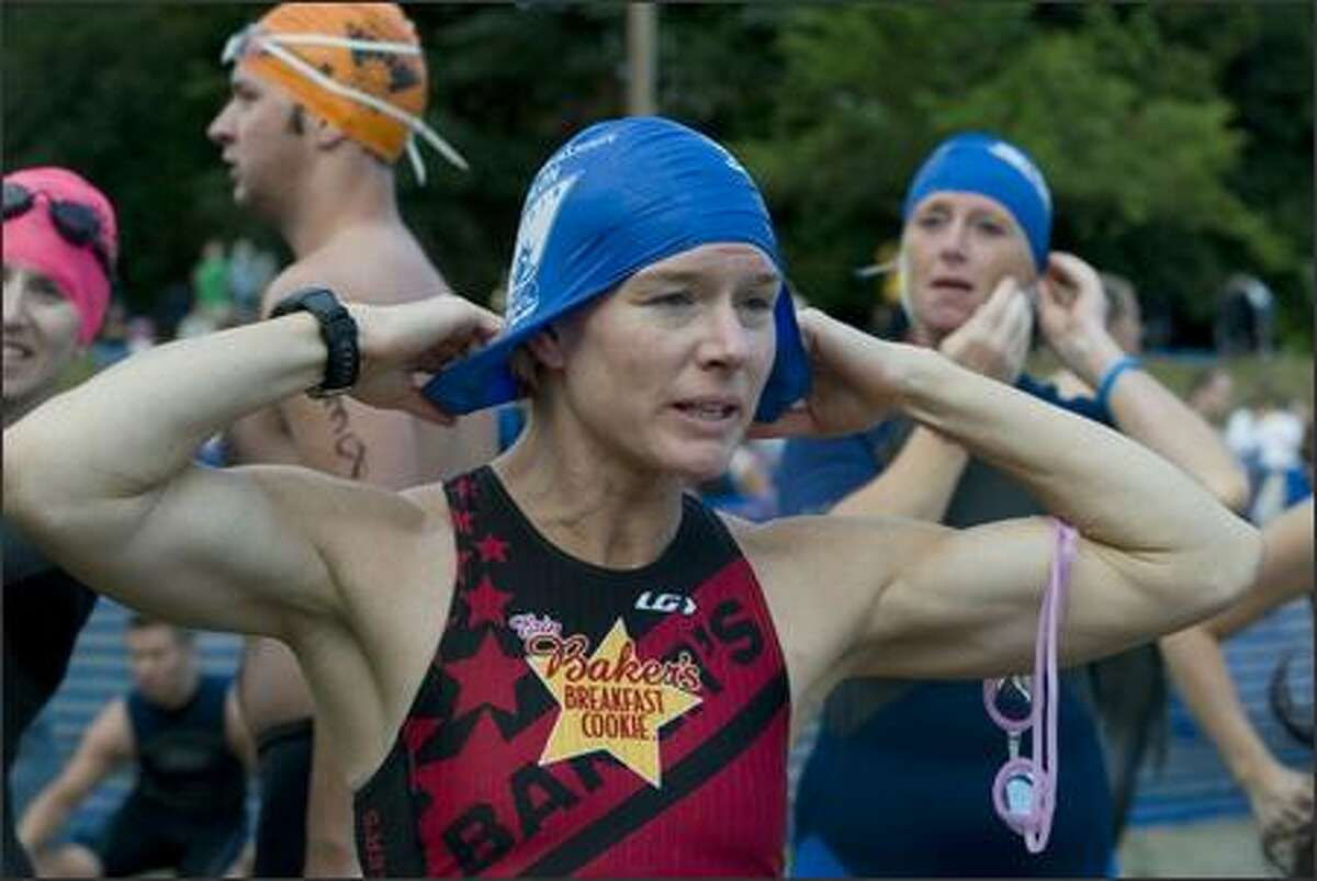 Anne Jensen of Kirkland adjusts her cap before the Benaroya Research Institute Triathlon.