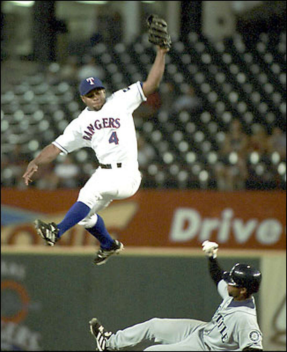 Desi Relaford steals second in the third inning as Rangers second baseman Donnie Sadler leaps for the throw. Relaford scored on John Olerud's double.