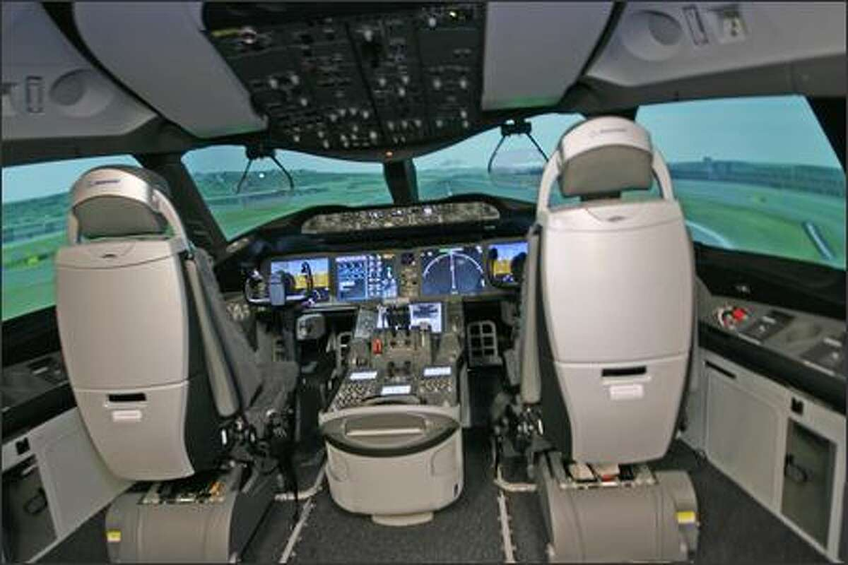 New Boeing 787 cockpit features new styled seats and more video screens, and 50 percent more viewing area than the 777.