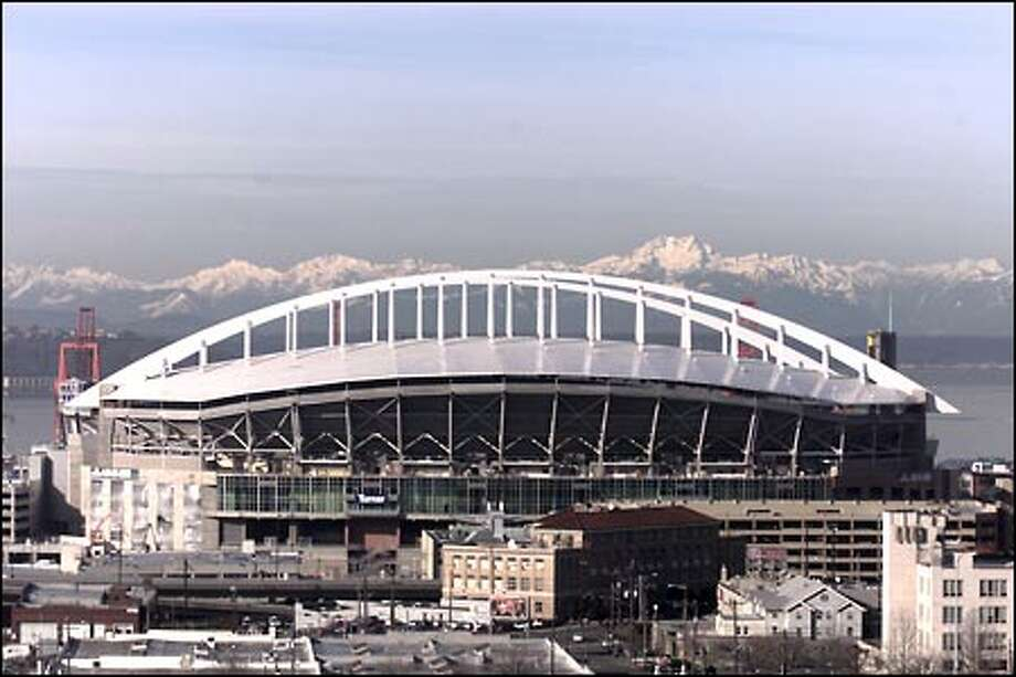 "The stadium's white ""rainbow"" roof fills the vacancy on Seattle's skyline opened by the Kingdome's implosion. A graceful steel bow truss recalls the arc of a long pass. Photo: Corky Trewin, Seattle Seahawks"