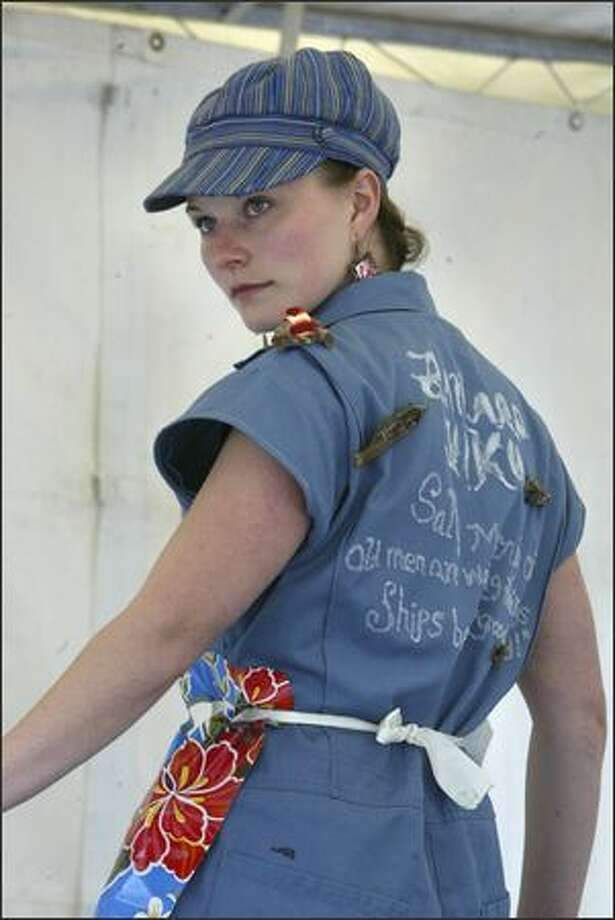 Ciara Griffin, of Ballard, displays her haiku-decorated coveralls for the crowd gathered to see the coverall competition at the 33nd Annual Ballard SeafoodFest. Photo: Andy Rogers, Seattle Post-Intelligencer