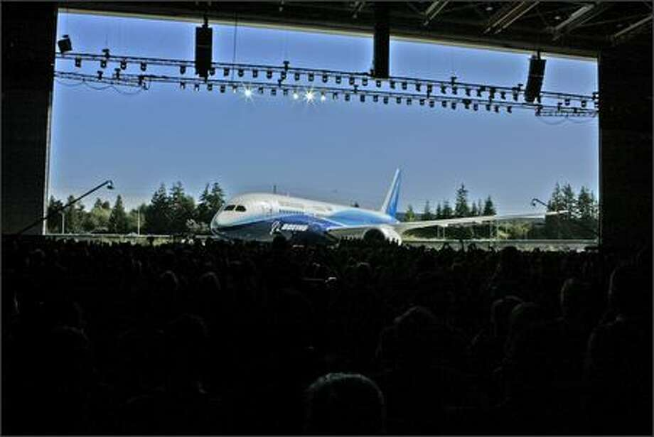The first production 787 Dreamliner stands revealed before a crowd of 15,000 current and former Boeing employees, 