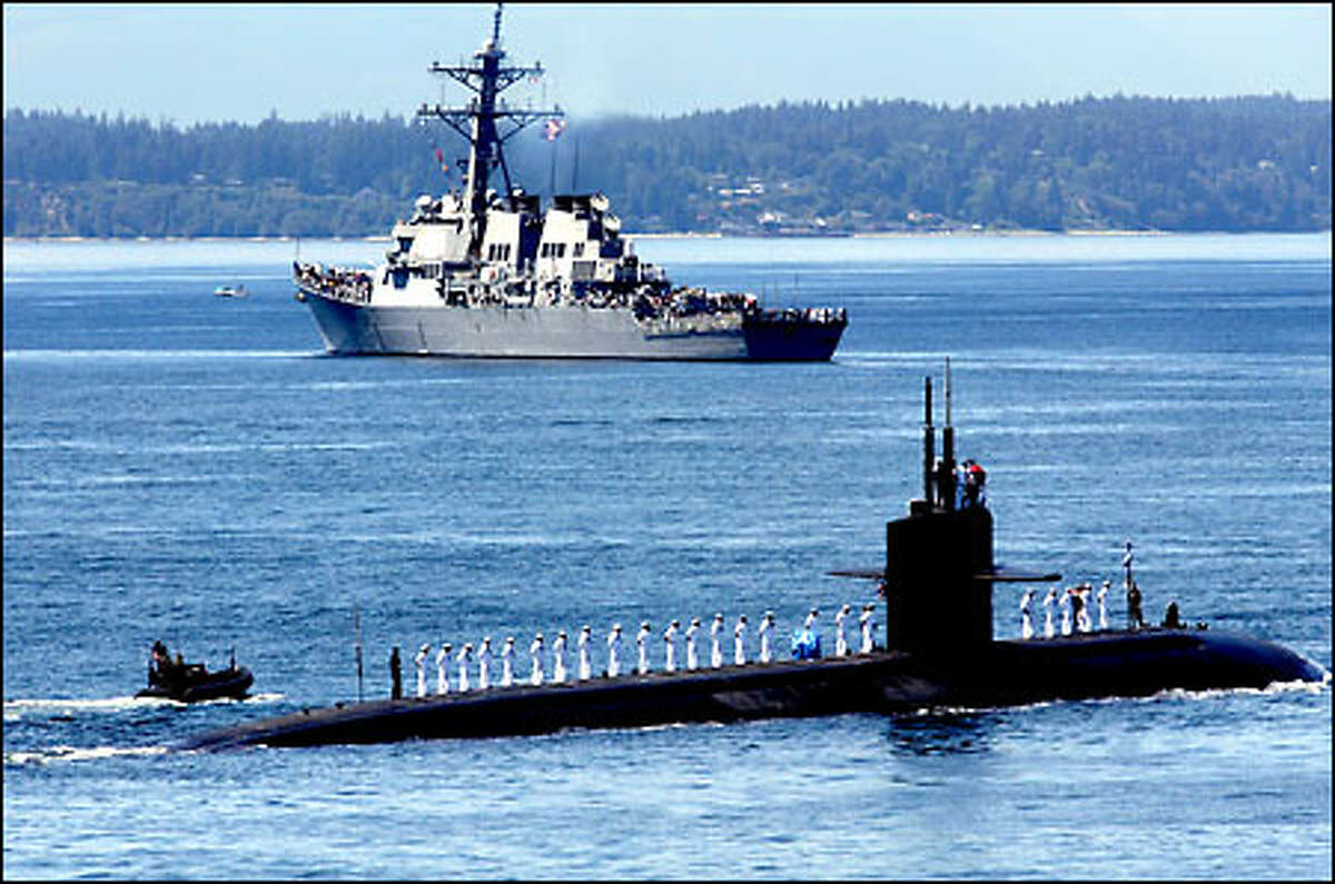 The fast-attack submarine USS Bremerton arrives in Elliott Bay for Seafair.