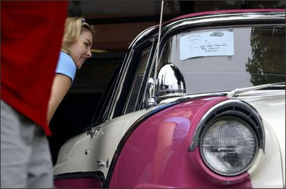 Susan Eng of Kirkland peeks at the interior of a 1955 Ford Crown Victoria at the Kirkland Classic Car Show Sunday. Photo: Andy Rogers, Seattle Post-Intelligencer