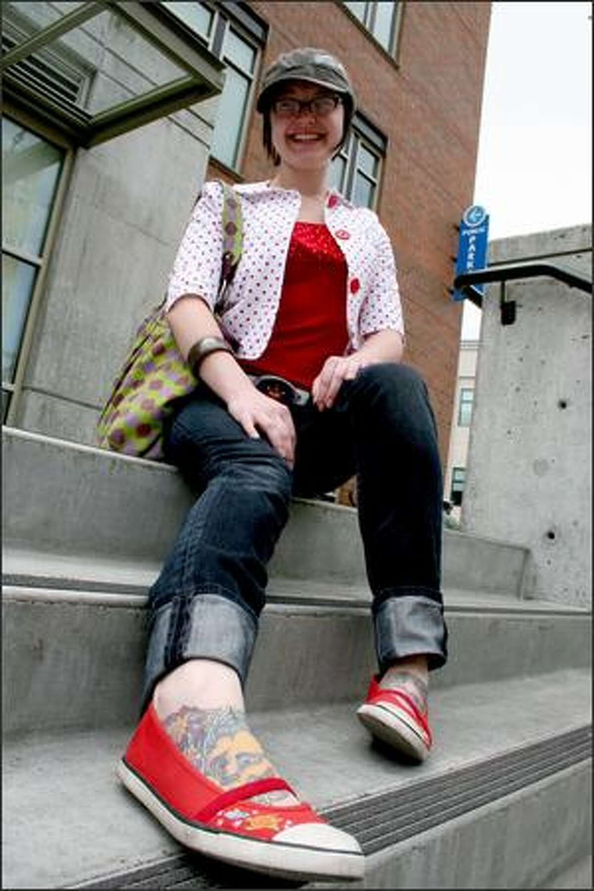Alexis Macauley relaxes outside the Sunday market. She goes for an
