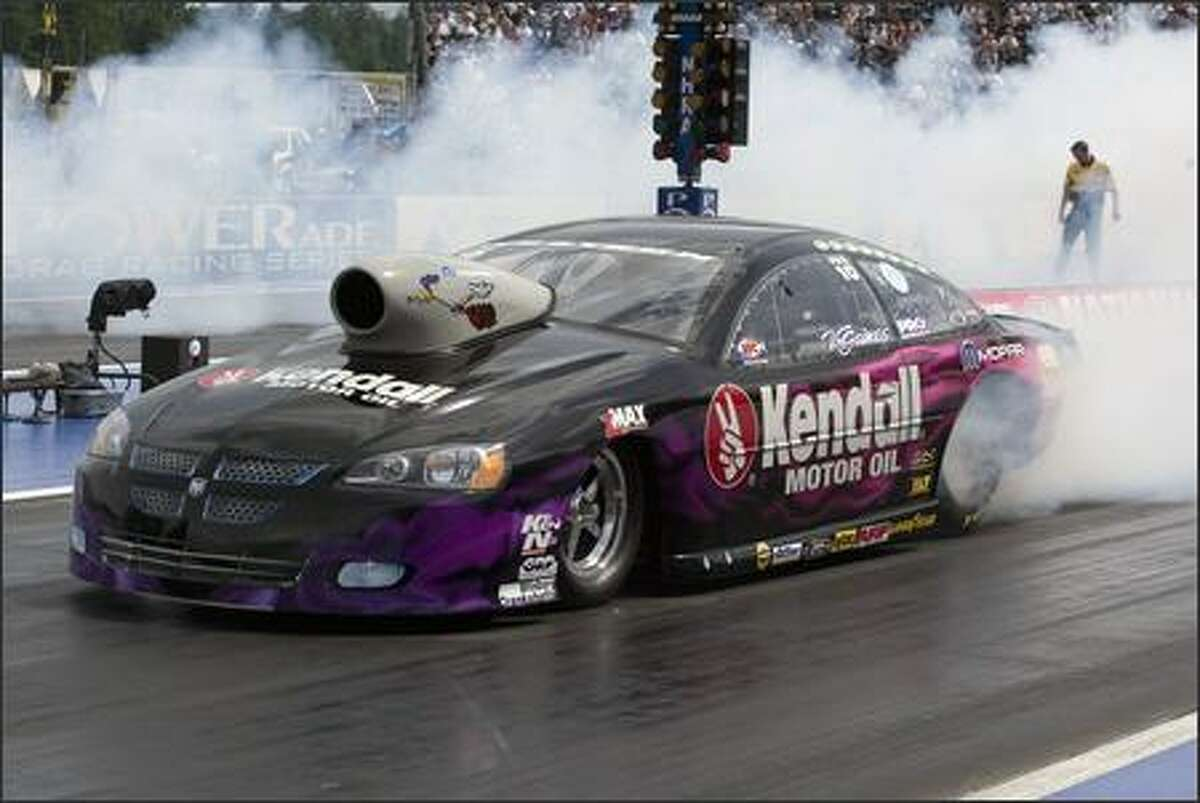 Vieri Gaines, driving a Kendall Dogde Stratus, warms up his tires before racing in the Pro Stock division of the Schuck's Auto Supply NHRA Nationals at Pacific Raceways in Kent. This is the 14th of 23 events in the NHRA POWERade Drag Racing Series.