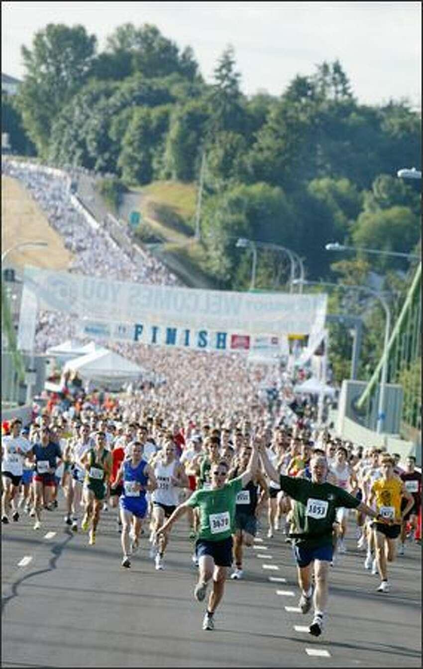 A 5K run started the day-long dedication celebration of the new Tacoma Narrows Bridge on Sunday.