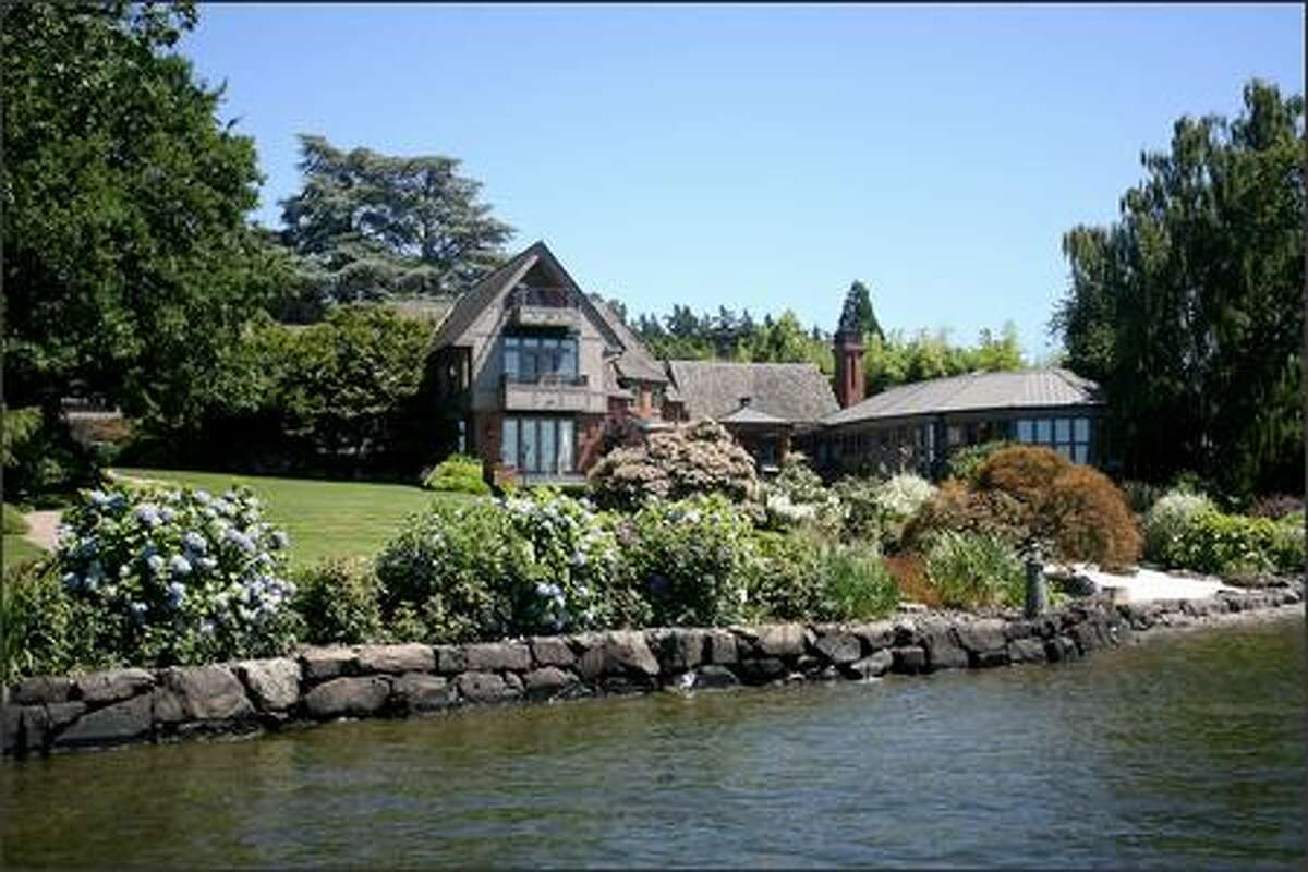 A view from the dock shows the Lake Washington-facing side of the Mercer Island home.