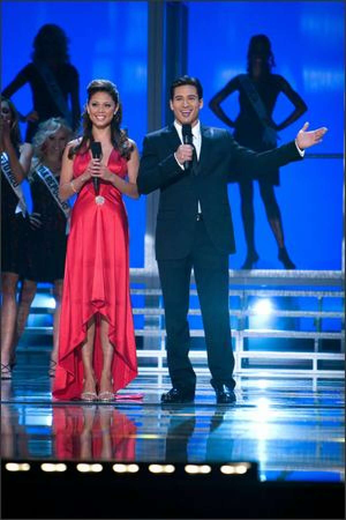 Co-hosts Vanessa Minnillo and Mario Lopez open the NBC broadcast of the 56th annual Miss Universe competition from the Auditorio Nacional in Mexico City.