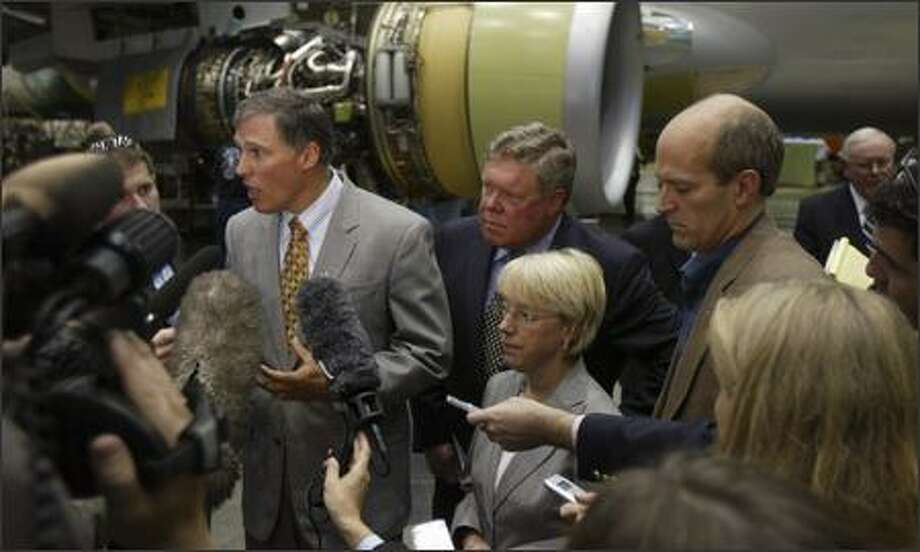 Rep. Jay Inslee, with Sen. Patty Murray and House colleagues Norm Dicks and Rick Larsen, celebrate Boeing winning huge Air Force tanker contract.  Inslee is quitting the House to run for governor, leaving 600,000 people without a congressman for much of the year.  Photo: Andy Rogers, Seattle Post-Intelligencer