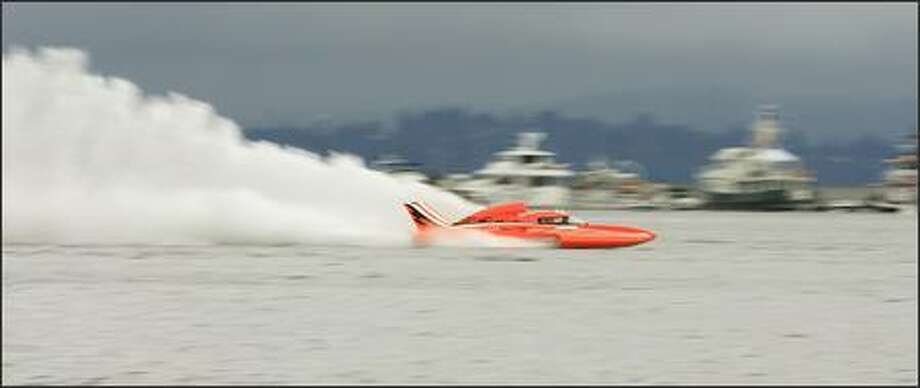 Mike Eacrett of G-24 Racing pilots his Unlimited Light boat across Lake Washington during qualifying at Seafair in Seattle on Friday. Photo: Dan DeLong, Seattle Post-Intelligencer