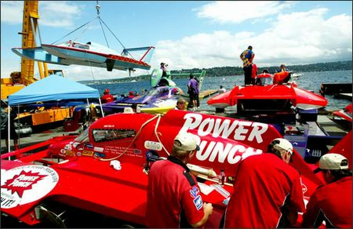 Crews work on unlimited hydroplanes in the pits during Seafair festivities on Lake Washington in Seattle on Friday.