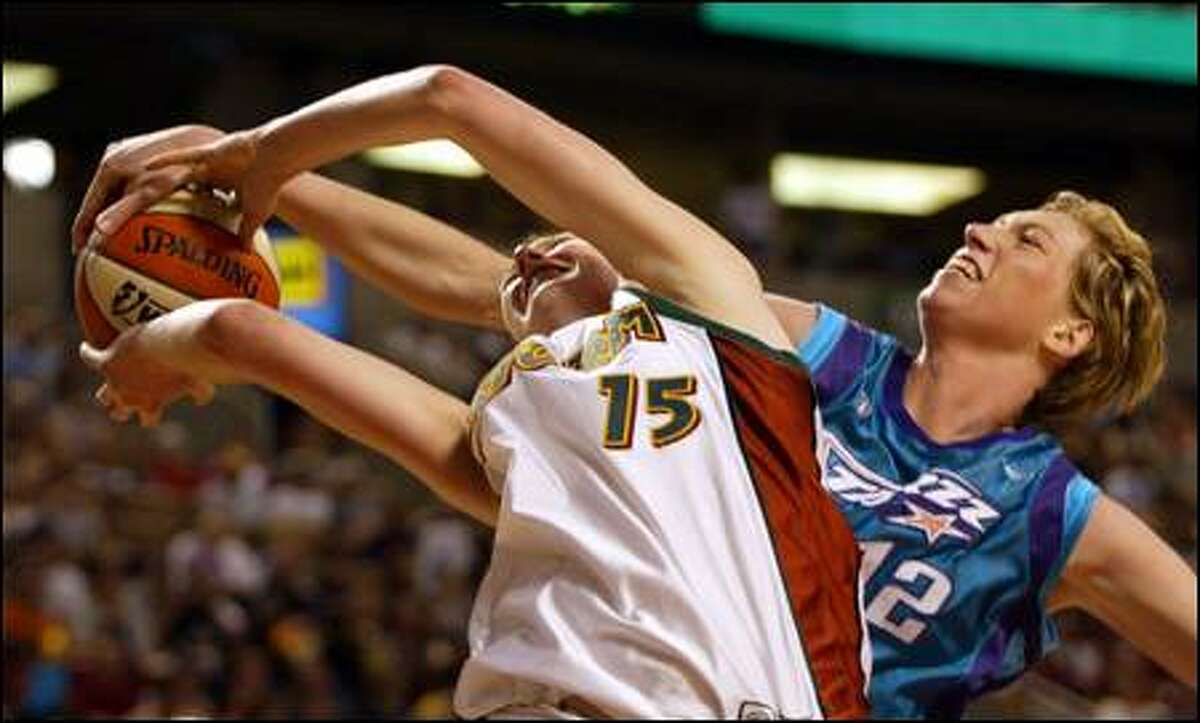 Utah's Margo Dydek fouls Lauren Jackson. They could meet again in the second round of the playoffs.