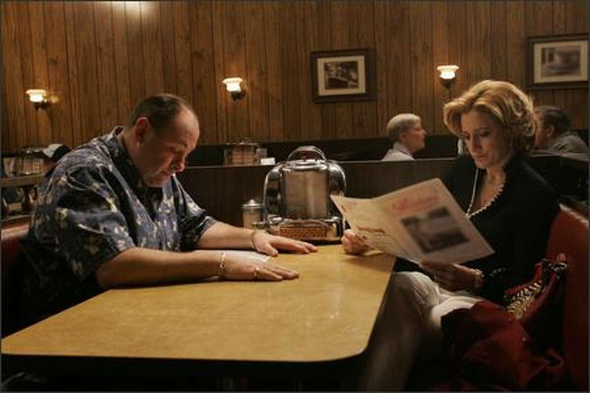 """The gang shows up for family dinner"" James Gandolfini (Tony Soprano) Edie Falco (Carmela) Robert Iler (Anthony Jr.) on The Sopranos."