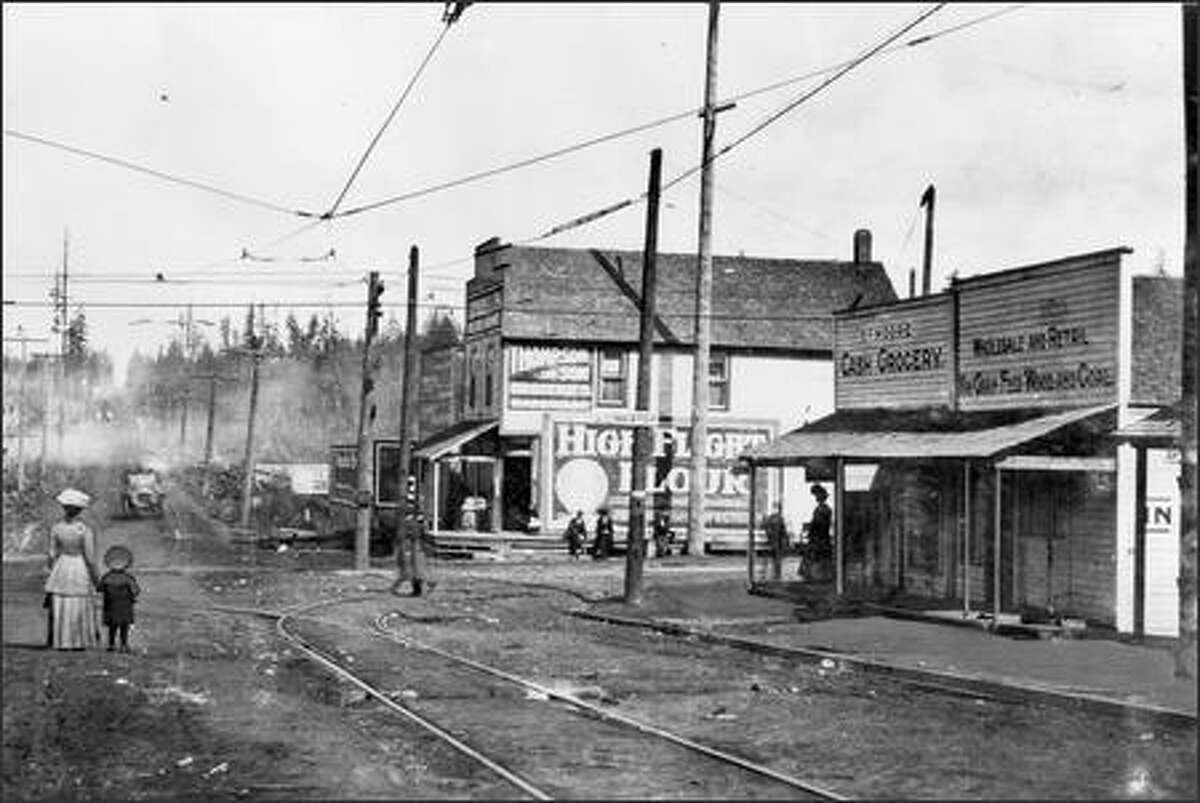 A mother and her son wait for the Interurban streetcar at North 85th Street and Greenwood Avenue North on Oct. 23, 1910. In that year, interurban service linked the community in the farthest reaches of the city with Ballard and other street car lines to the South. North 85th Street served as the long-time city boundary until annexations.