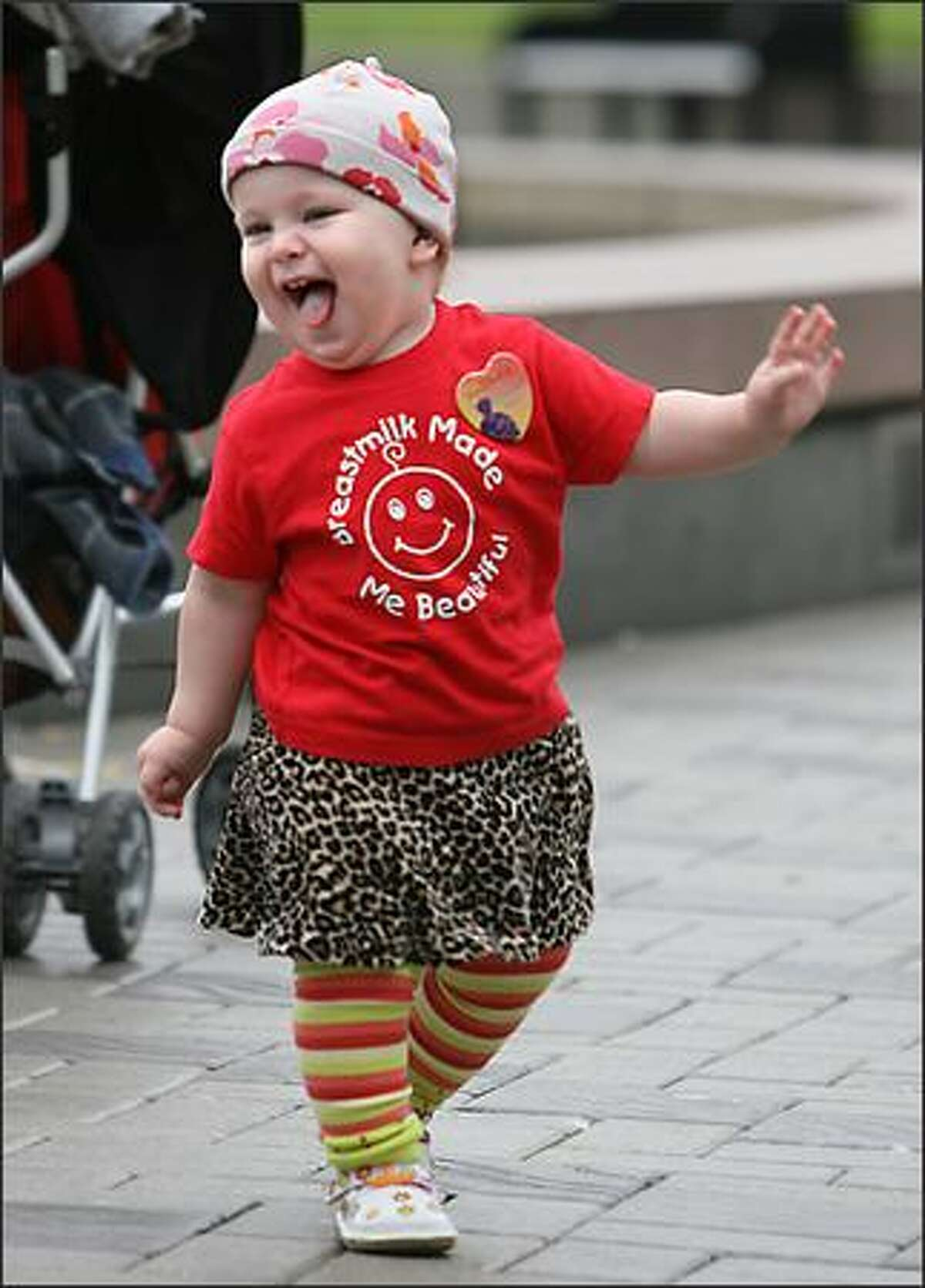 Isabella Biggs, 15 months, dances around the Seattle Center International Fountain as her shirt says it all: