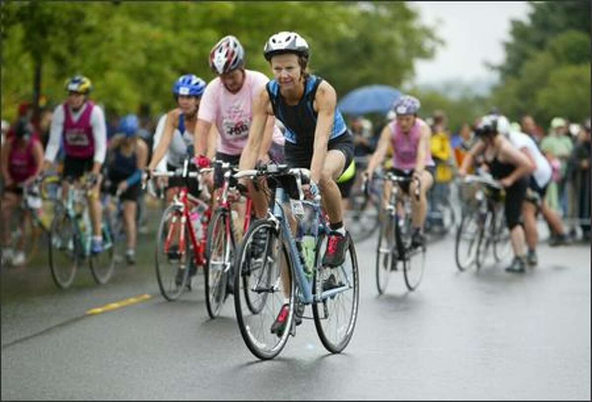 Danskin Women's Triathlon participants begin the biking portion of the race along Lake Washington Boulevard.