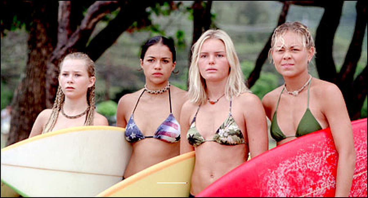 Surfers Penny (Mika Boorem), Eden (Michelle Rodriguez), Anne Marie (Kate Bosworth) and Lena (Sanoe Lake) size up the waves at the Pipeline on the North shore of Oahu.