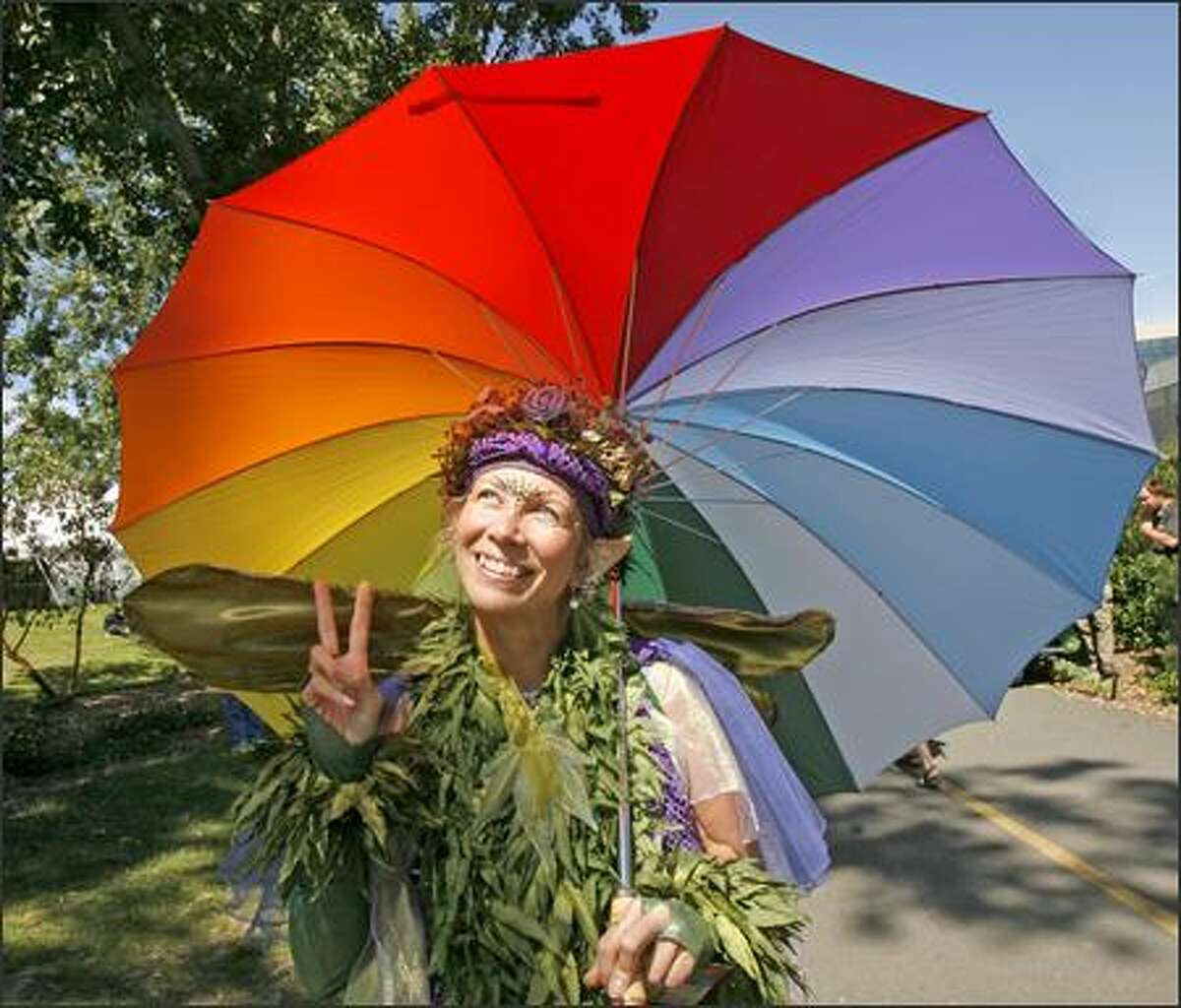 Pakalanalani (Heavenly Plant), as she calls herself, checks out the bright sunshine falling on Hempfest in Myrtle Edwards Park Saturday morning. The forecast called for rain but the day started bright and sunny.