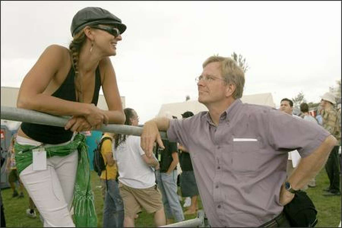 Rick Steves, travel writer and public television producer, right, talks with Avi Ludwig, stage speaker coordinator, before he makes his presentation on the Share Parker Main Stage at Hempfest 2007.